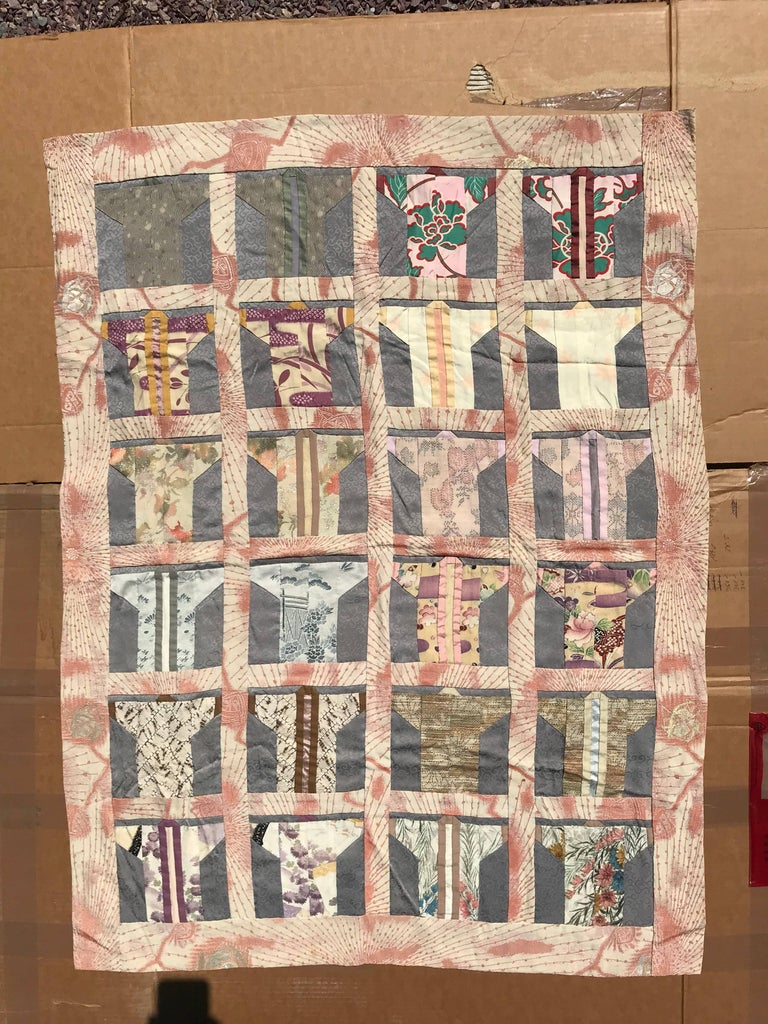 An exceptionally fine quality Japanese hand sewn small fabric quilt wall art crafted from 19th-20th century Kimono fabric in the form of miniature kimono.  Pretty pastels.  It is immediately and eminently frameable if you so desire.   This is an