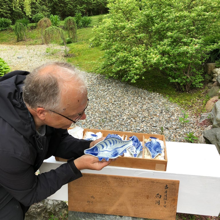 Fresh find for nautical and seaside enthusiasts from our recent Japanese acquisition travels  Hand painted in stunning blue and white colors comes this desirable set of five (5) beautiful antique ceramicfish or koi plates dating to the early 20th