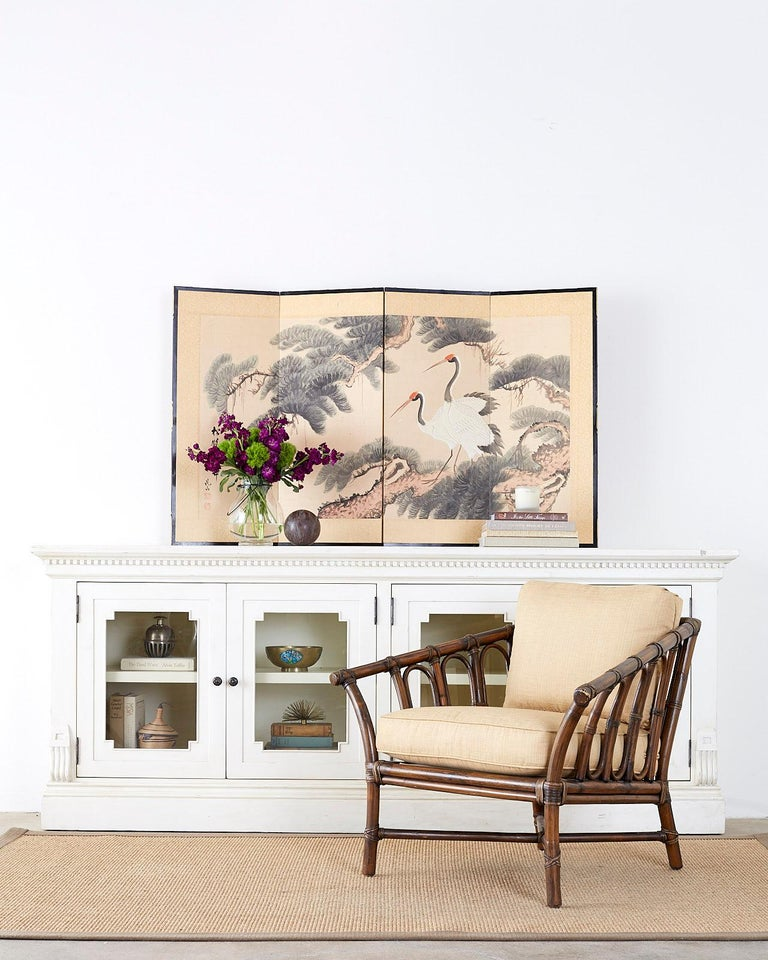 Beautiful Japanese four-panel byobu screen titled pine cranes and longevity. Depicts two red crowned cranes or Manchurian cranes perched in a pine tree. Lovely details with ink and color on silk ground. Signed and titled on left side by artiest
