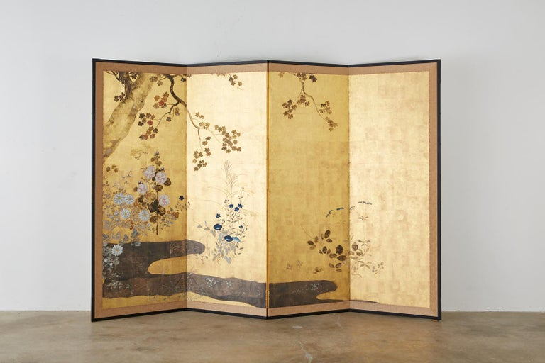 Magnificent Japanese four-panel 19th century Meiji screen. Made in the Rimpa School style depicting a serene floral autumn landscape. Beautifully painted sumi ink and color pigments over gold and silver leaf squares. Delicate flowers of