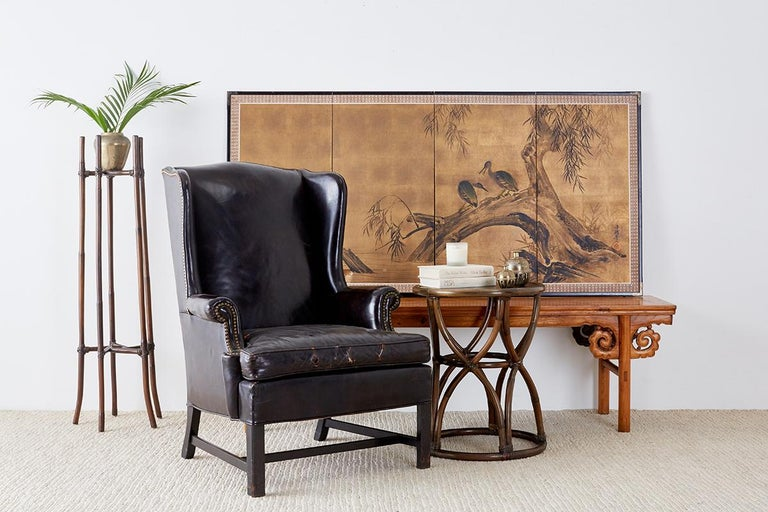 Charming Japanese four-panel byobu screen depicting two blue herons sitting on a willow tree seemingly talking to each other. Ink and color painted on gold paper by Kozui Hitsu signed with one seal on the left side. Made in the Nihonga School style