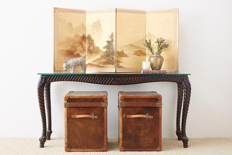 Idyllic Japanese four-panel screen depicting a mountain river landscape. Painted on water silk with artist signature Hiroaki and two seals. Ink and color painting set in a giltwood frame with a silk brocade border.