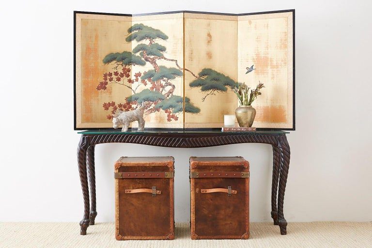 Midcentury Japanese four-panel screen depicting a pine tree and maple tree with a sparrow. Ink and color pigments over a printed silk ground of distressed squares of gilt. Set in a lacquered frame with a silk brocade border.