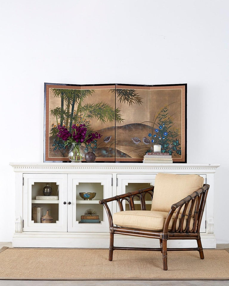 Colorful Japanese four-panel byobu screen of three quail in a flowering bamboo landscape. Ink and color pigments on a gilt printed paper. Signed by artist Shunso on right side and set in a black lacquered wood frame with a silk brocade border.