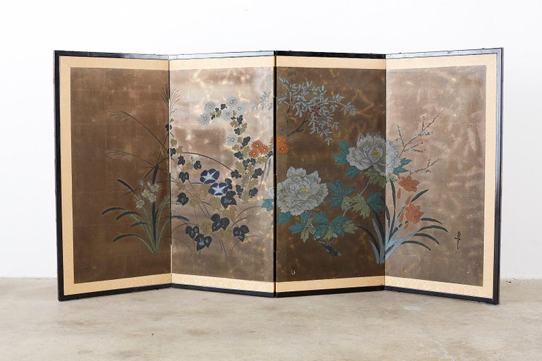 Lacquered Japanese Four-Panel Screen Seasonal Flowers on Gilt For Sale