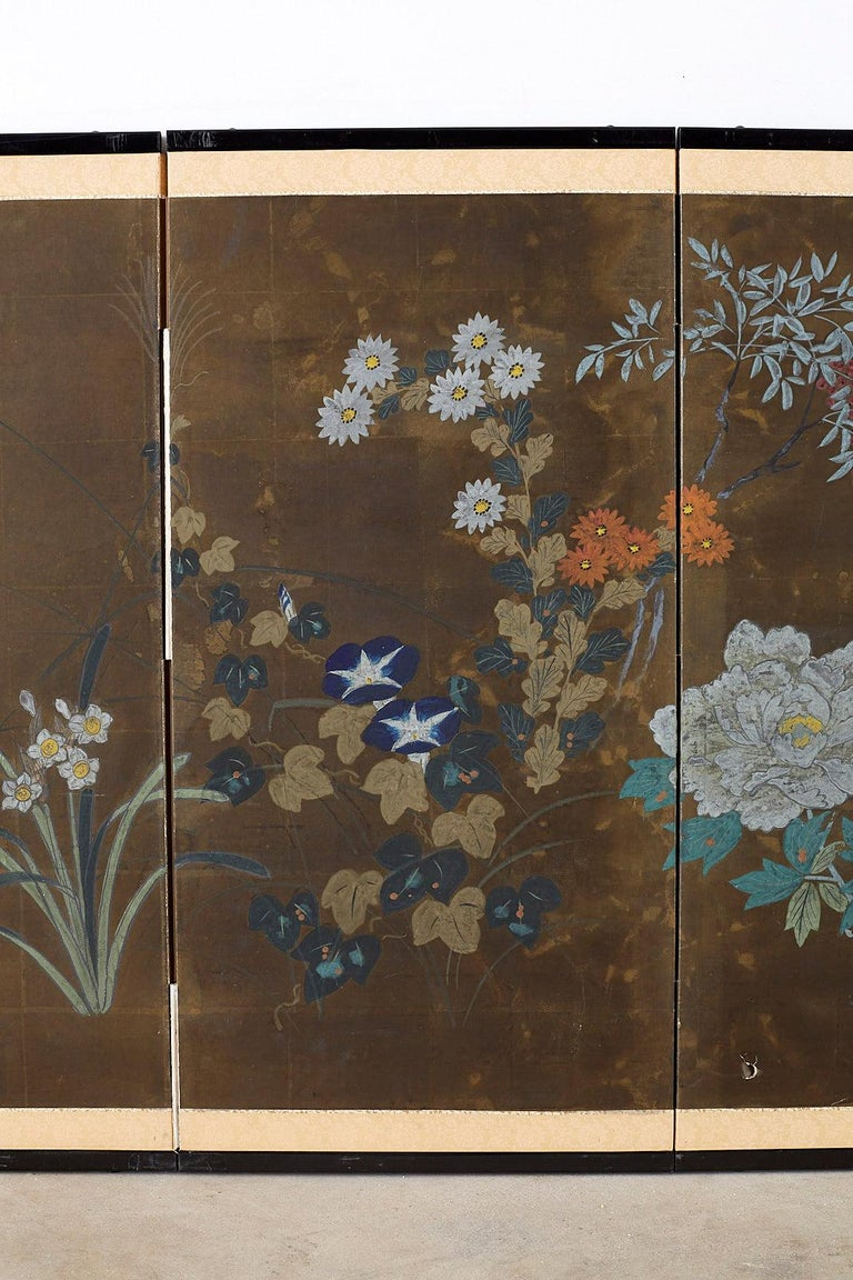 20th Century Japanese Four-Panel Screen Seasonal Flowers on Gilt For Sale