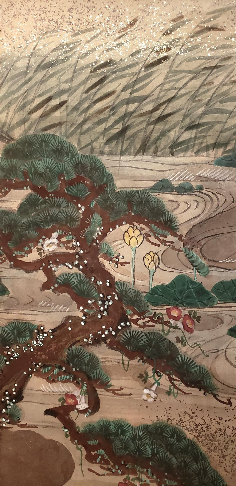 Japanese four-panel screen: Water landscape, Meiji period (1868-1912) painting of a waterfall on the left, leading to a meandering stream amongst a hilly landscape. Lotus flowers and leaves rise above the surface, water grasses bend in the breeze,