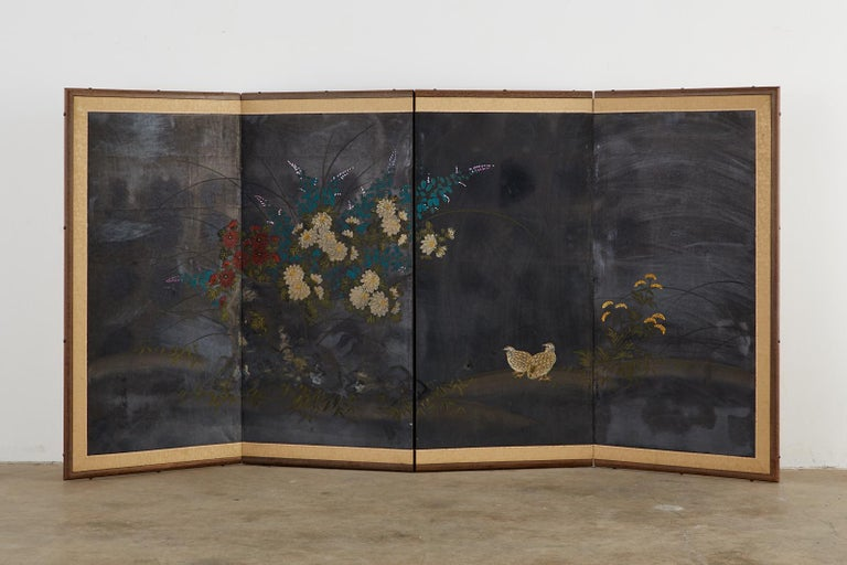 Dramatic Japanese Showa period four-panel byobu screen depicting two quail. Set amid a floral landscape of peonies, iris, and grass, the screen has a dark, patinated silver background on the finish appearing almost black. Signed by artist with a