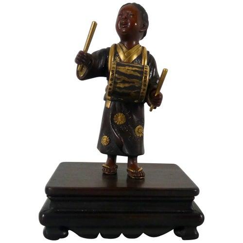Japanese Gilt Bronze Okimono of a Boy, Meiji Period