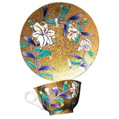 Japanese Gilt White Porcelain Cup and Saucer by Master Artist