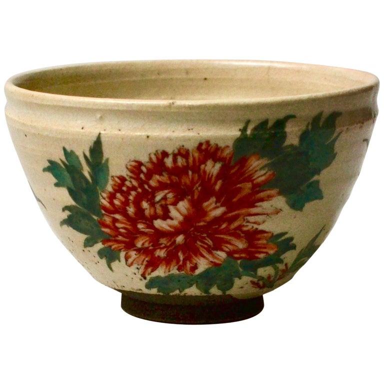 Japanese Glazed Tea Bowl with Floral Decoration For Sale