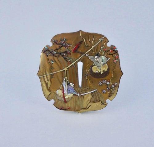 Japanese gold lacquer and Shibayama inlaid tsuba. Signed Shinzan. Meiji Period.