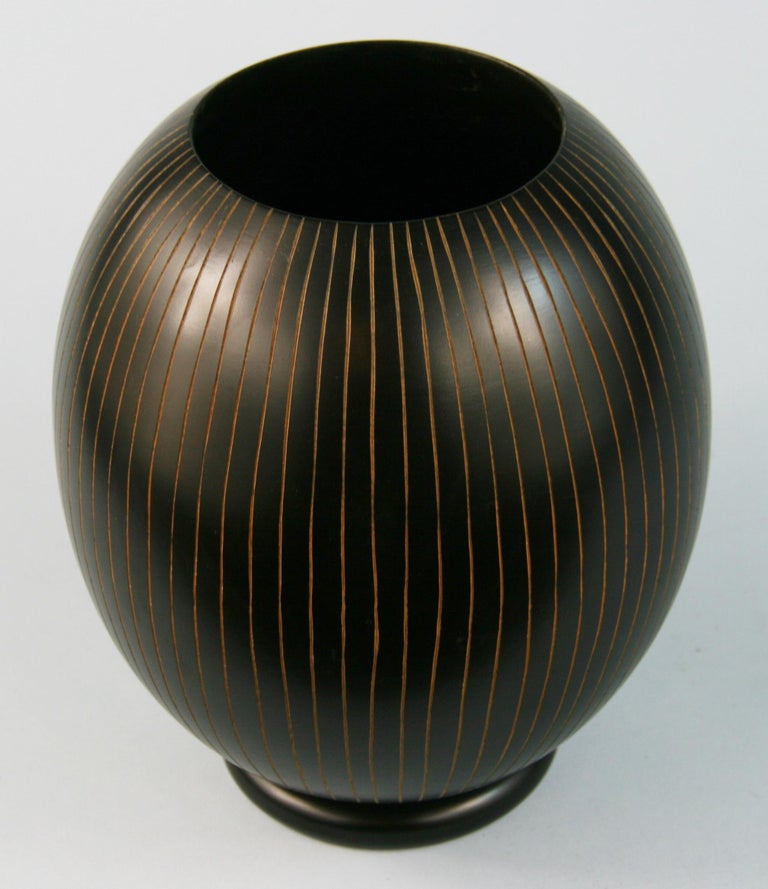 3-617 Japanese hand turned wood vase with concentric groves.