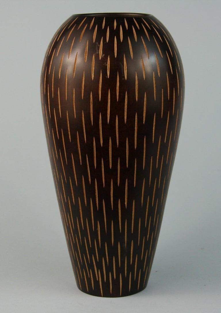 3-616 Japanese hand turned wood vase with vertical slits.