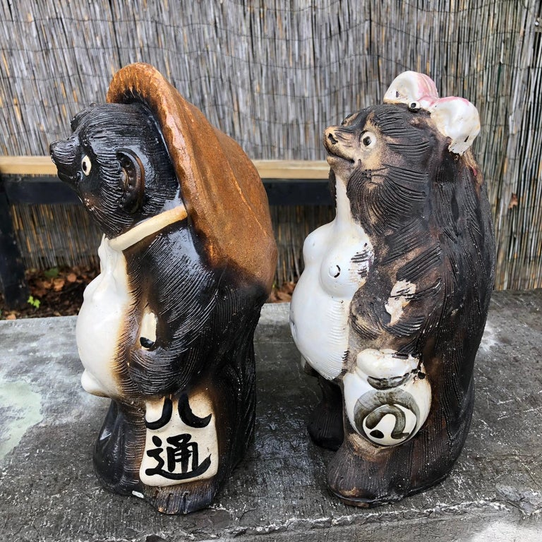Matching Pair Charming Signed Sculptures Ready to take your Sake Order  An older pair of fun loving Him and Her handmade and hand glazed and big bellied Folk art Hero Tanukis- raccoon dog party animals from Japan.  Brandishing their sake order