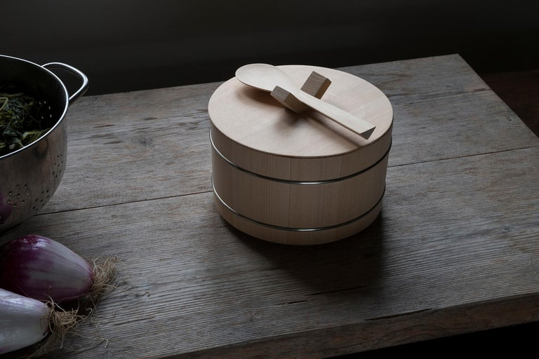 Shori is a reinterpretation of the Ohitsu, the traditional Japanese rice container. The heart of the project is the V-shaped knob on the lid; this allows, during use on the table, to hook the lid to the container avoiding to occupy further space on