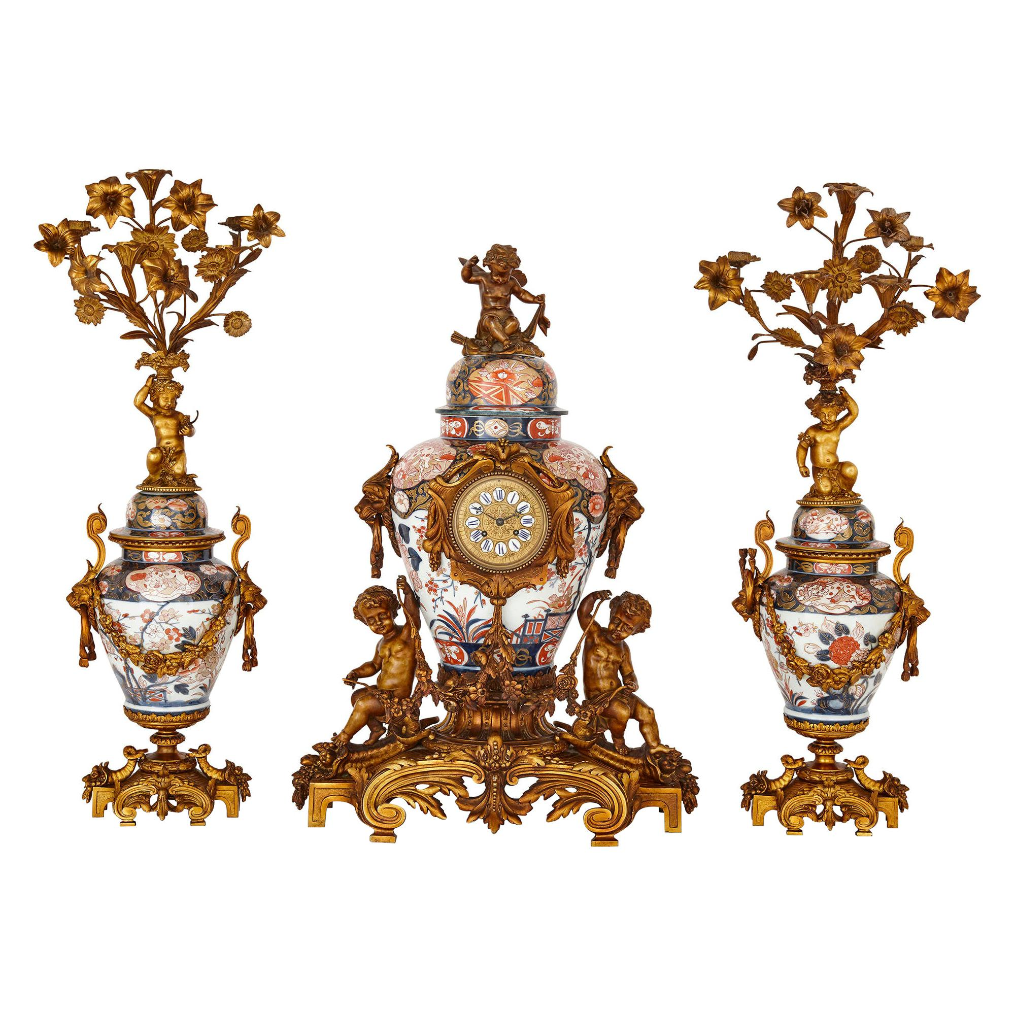 Japanese Imari Porcelain and Gilt Bronze Clock Set