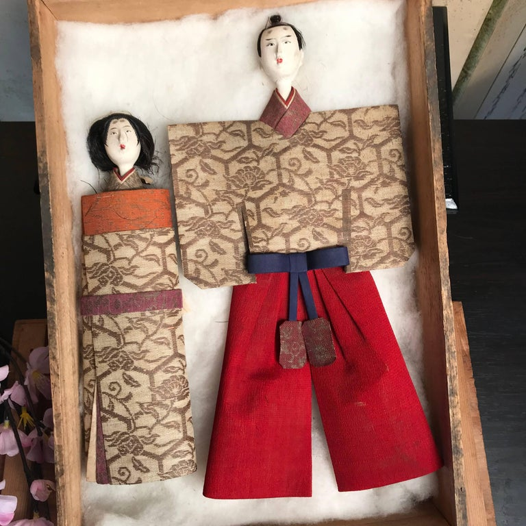 From our recent Japanese acquisitions travels.  A rare couple.  These Japanese Tachibina dolls represent the simplest essential form of the imperial couple. Their beautiful faces were crafted from crushed shell called gofun coated over carved wood