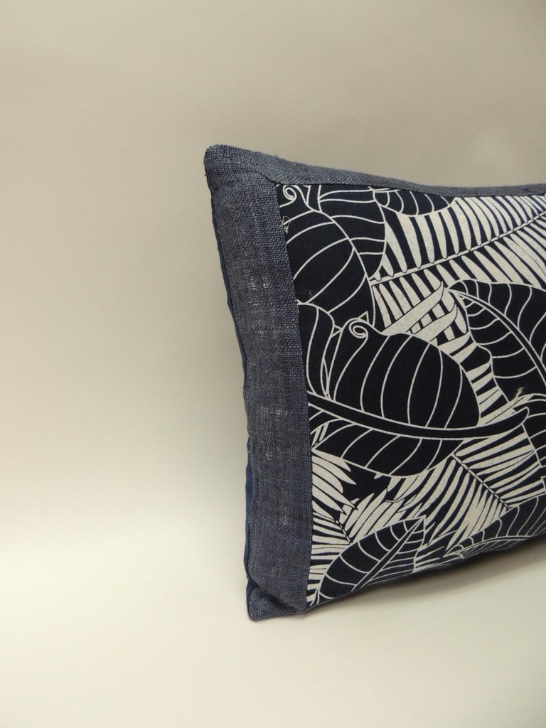 Japanese indigo and white bolster pillow, depicting palm fronds and banana leaves, framed  with home-spun blue linen and royal blue linen backing. Pillow hand-made with an  artisanal textile and designed in the USA. Closure by stitch (no zipper)
