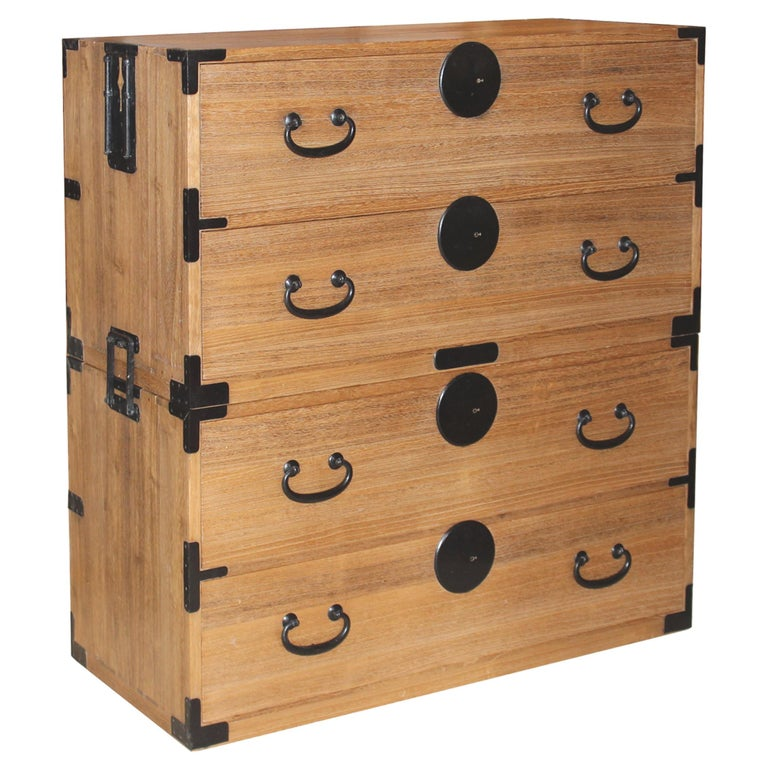 Japanese two section clothing chest. Solid kiriwood chest with original iron hardware and round lock plates. Versatile two section Japanese clothing chest can stand alone or can be used separately as bedside chests. Meiji period, circa 1885.