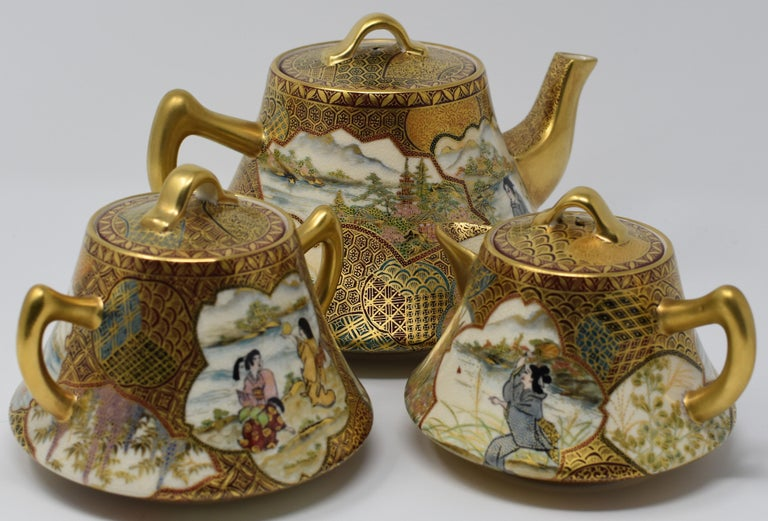 Unique exceptional three-piece gilded with high purity gold and intricately hand-painted in red and green, a 20th century masterpiece of the Kutani kilns of central Japan. The set combines two distinct traditional Japanese arts– extremely detailed