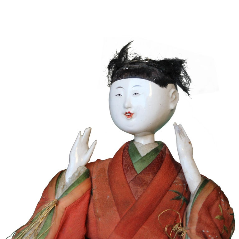 Master artisans skillfully crafted the Kyoto doll with lacquered wood head and hands, dressed in Classic Japanese style clothes made from antique kimono textiles. Doll depicts one of the musicians in traditional Japanese Noh theatre. Meiji period,