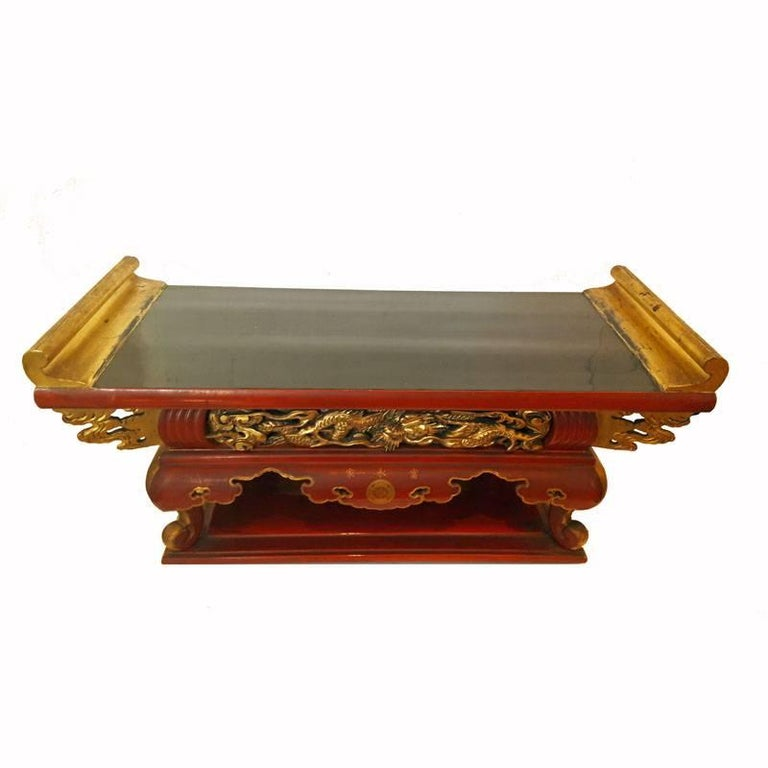 A Japanese lacquered altar table, Meiji Period, late 19th century. Exquisitely carved dragon design in the front, black / red lacquer and gilt trimmings.