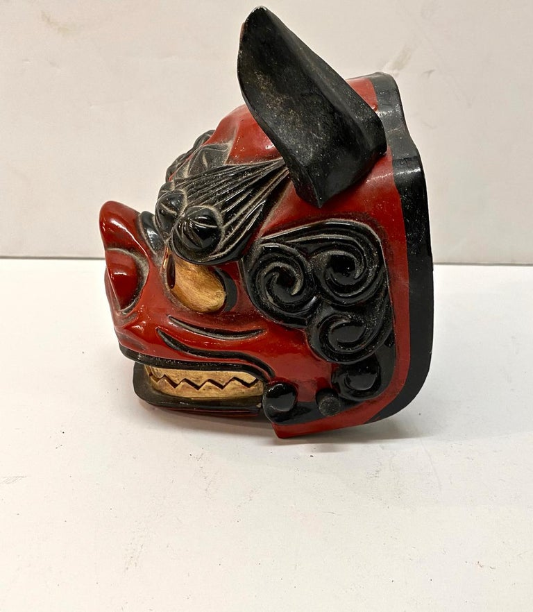 Traditional Japanese lion mask dating to the mid-20th century. The masks is in overall very good condition and would make an eye-catcher decorative element. Lion masks were used in the performance of the lion dance of the Matsuri Festival. The