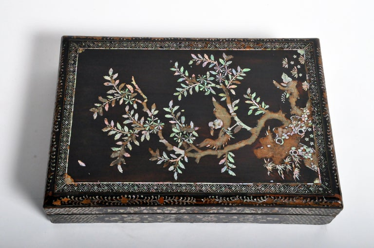"Elegant lacquerware box from Japan made from mother of pearl and lacquer, circa 19th century. The box comes with a ""Certificate of Authenticity"" from Takashimaya Co., Ltd."