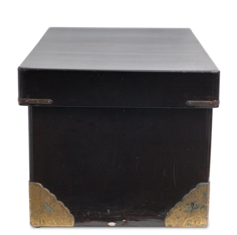 "Offered is a Meiji Japanese 19th century lidded lacquered wood traveling chest with elaborate decorated gilded brass mountings. The chest measures 14"" x 28"" x 17 ""The chest evidences some losses and wear commensurate with its age."