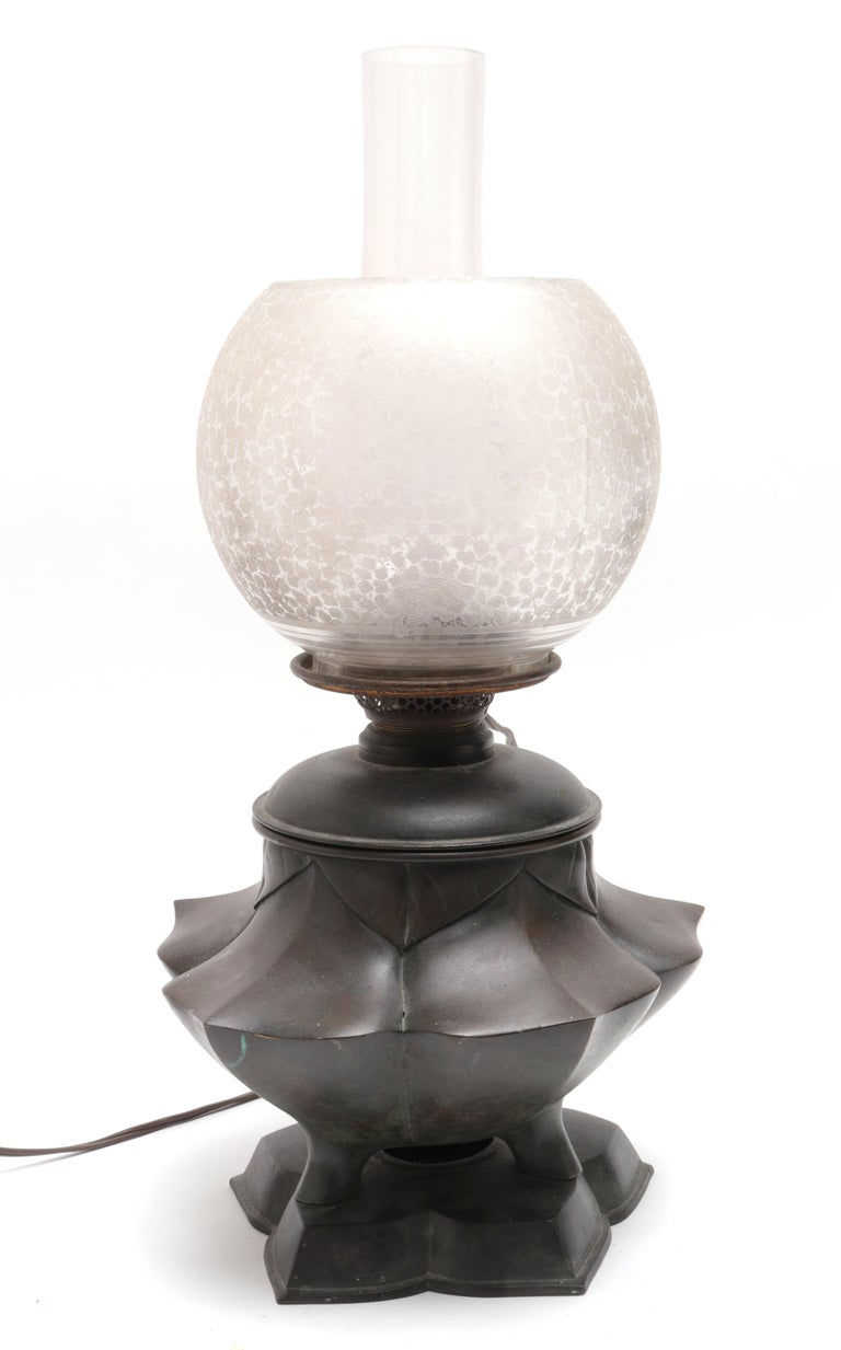 Japanese Meiji period electrified oil table lamp with lotus shaped base and original glass shades. The piece is in great antique condition with age-appropriate wear and use and a desirable patina on the bronze.