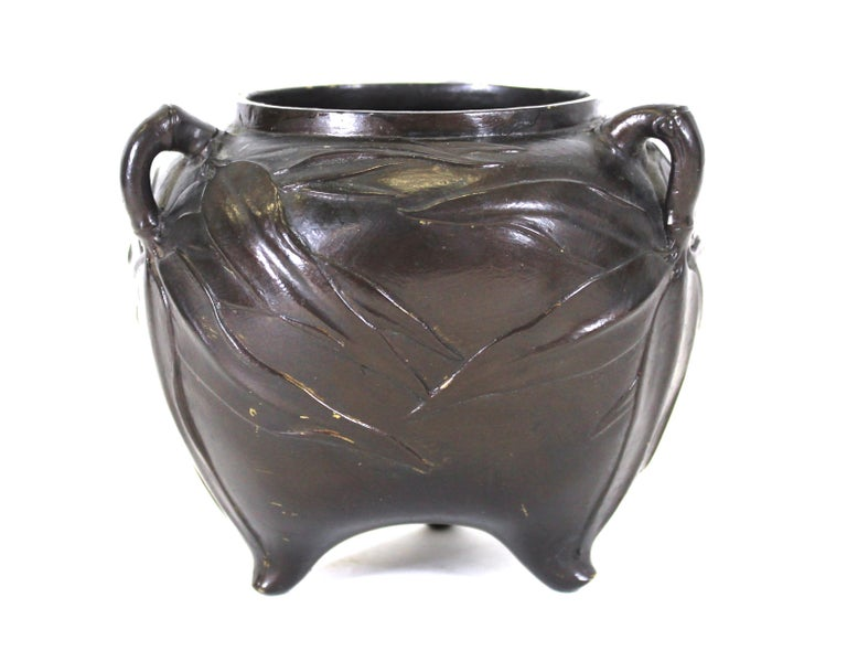 Japanese Meiji period bronze tripod vessel with laurel leaves in relief. Old repair work on the inside.
