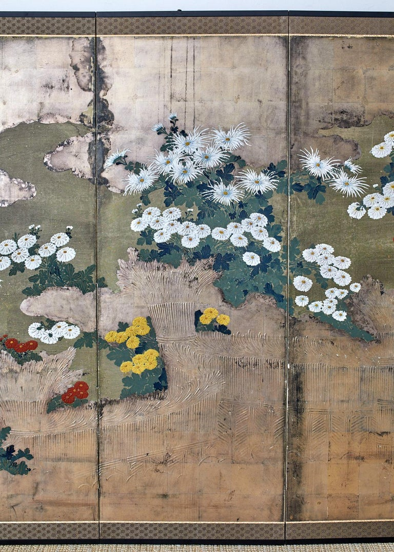 Lacquered Japanese Meiji Four Panel Screen Chrysanthemums Along a Fence For Sale