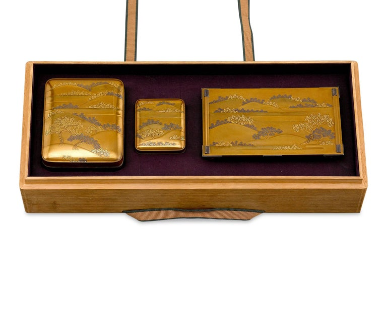 This remarkable Japanese portable writing set contains the instruments of sublime artistic expression. Also known as a yatate, this Meiji-period set includes a low writing table, an ink stone, or suzuri and water dropper, or mizusashi, in a compact