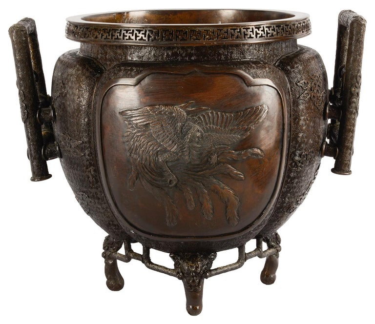 A very good quality 19th century, Meiji period (1868-1912) Bronze two handled jardiniere, having wonderful engraved and embossed classical motifs and inset panels depicting mythical dragon and bird like creatures. Measures: 40cm (16