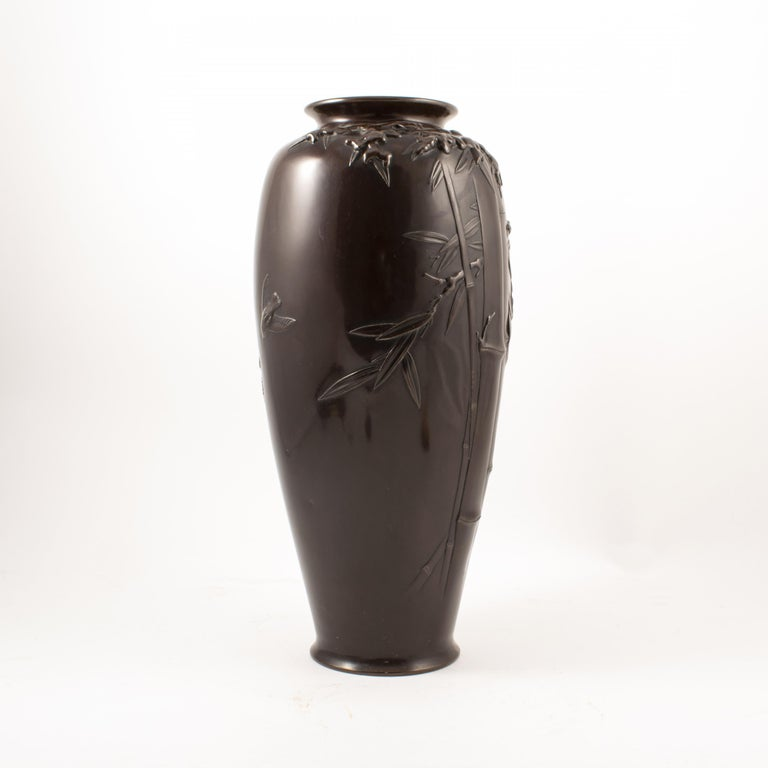 Japanese dark patinated bronze vase. Embossed with bamboo and bird's motifs. Late Meiji period, circa 1900. Base has makers mark / signature.