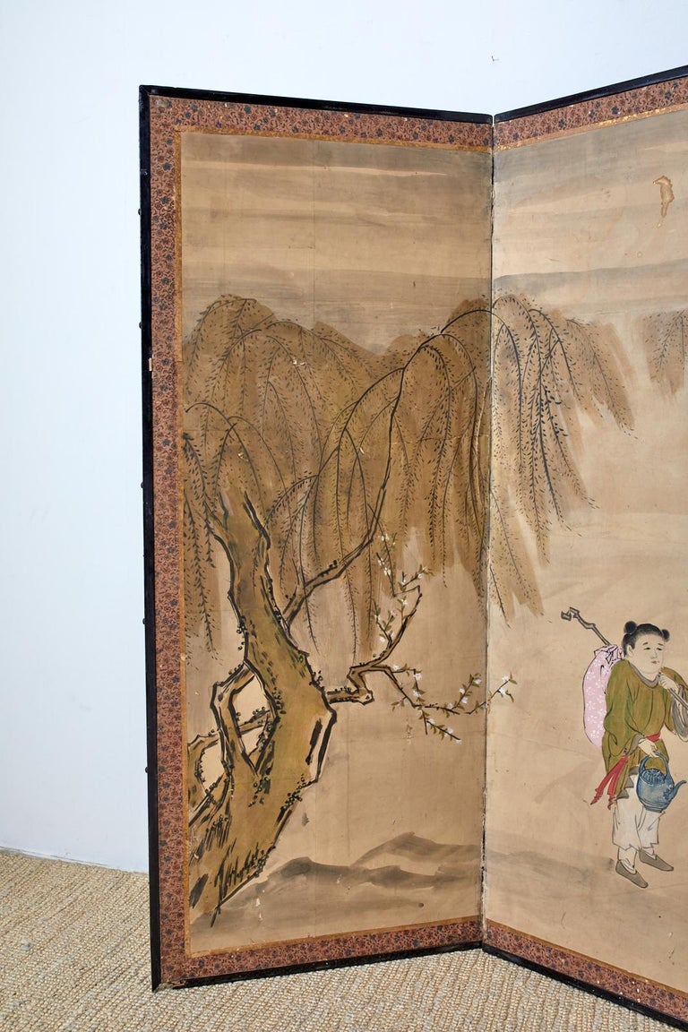 Large 19th century late Meiji period Japanese six-panel painted screen. Depicting a scholar and travelers encountering a Chinese sage riding a donkey. Inscribed with a cursive script poem in the middle. Beautifully faded and aged patina. Ink and