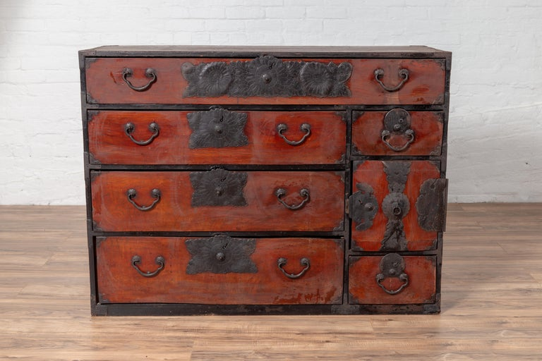 A Japanese Meiji period tansu clothing chest in the Sendai Isho-dansu style, made of Keyaki wood with hand-cut iron hardware. Born during the 19th century, this keyaki (elm) wood tansu is a fine example of Japan's traditional mobile cabinetry.