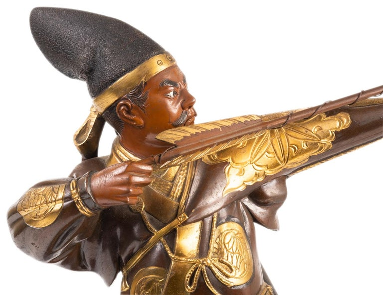 A very good quality Japanese Miyao style bronze statue of a warrior holding a bow and arrow. Having wonderful gilded detail to his clothing. Meiji period 1868-1912, signed plaque to the reverse.