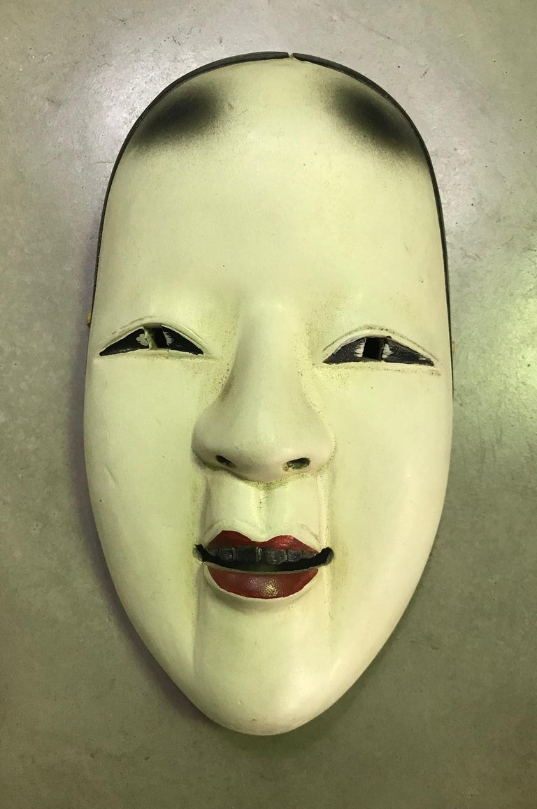 A beautiful, wonderfully crafted, alluring mask made for Japanese Noh theater.  This mask is handcrafted and carved from natural wood.  Ko-omote translates as