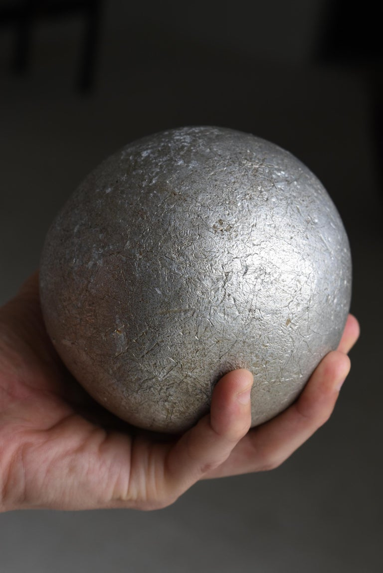 It is a rolled ball of aluminum cigarette paper. After many years this was completed. It's very rare.  This is a great work of art.  Weight 4 kg.