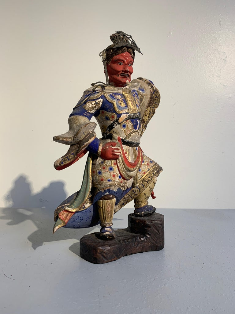 A striking Japanese carved and painted wooden temple figure of a Buddhist Heavenly King, Edo Period late 18th century. Although he is missing his identifying attribute, based on his stance and color of his face, it is most likely that this sculpture