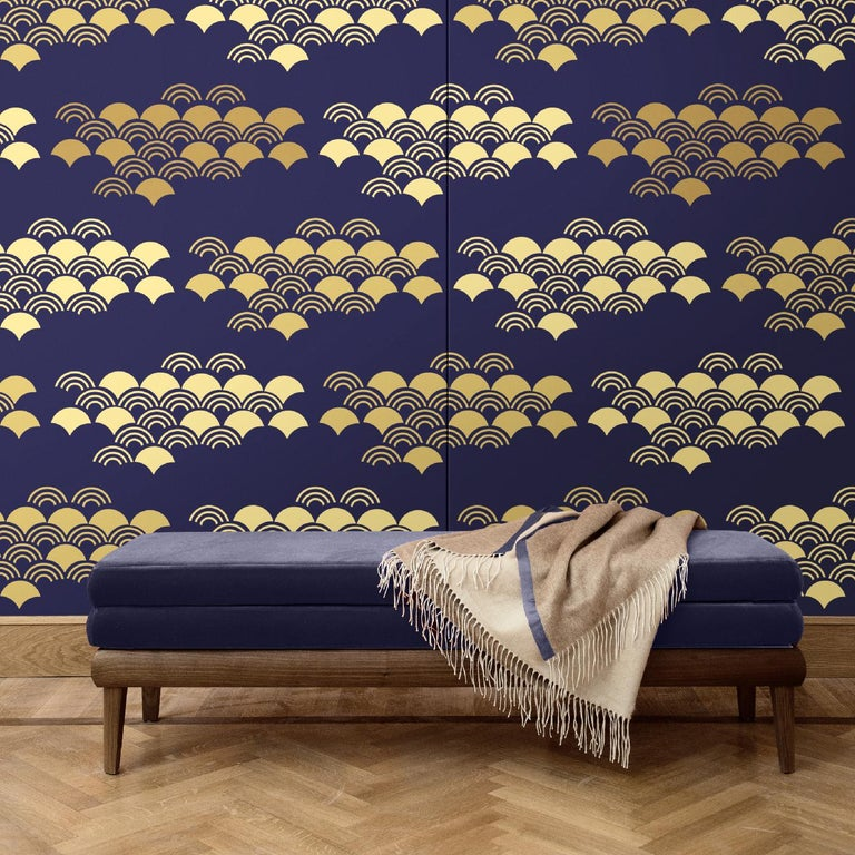Inspired by the graphic character of Japanese art, this wall covering depicts a series of stylized fan-shapes. It comes in blue, red, green and yellow. The complementing colors create a visually impactful effect that is modern and sophisticated.