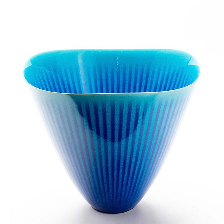 Exceptionally fine Japanese porcelain blue and turquoise striped Studio Vase by Atsushi Miyanishi.   This stunning contemporary bowl is a statement piece all on it's own. With sky blue stripes under a cobalt blue enamel over-glaze and a gently