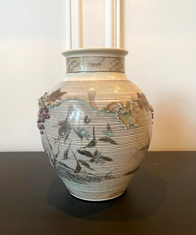 A rare porcelain vase by Makuzu Kozan (1842-1916) circa 1890-1900s (late Meiji period). The vase is dated to the earlier work from Kozan's studio during a short period when surface relief sculpturing was used as a distinguished technique was