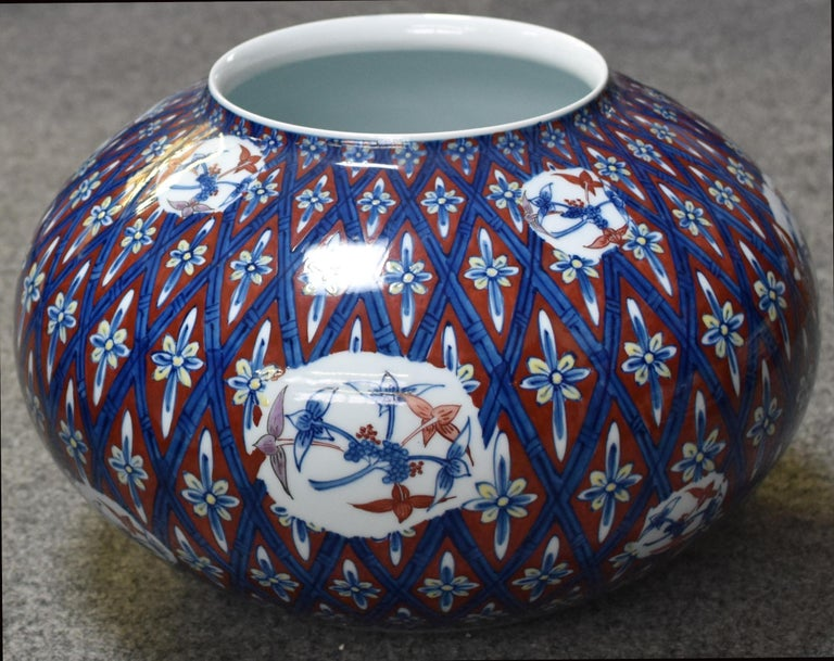 Large Japanese Contemporary decorative porcelain vase in a striking shape, hand painted in blue, white and red to create a signature geometric pattern with blue lines showcasing bamboo branches. A masterpiece by a widely respected award-winning