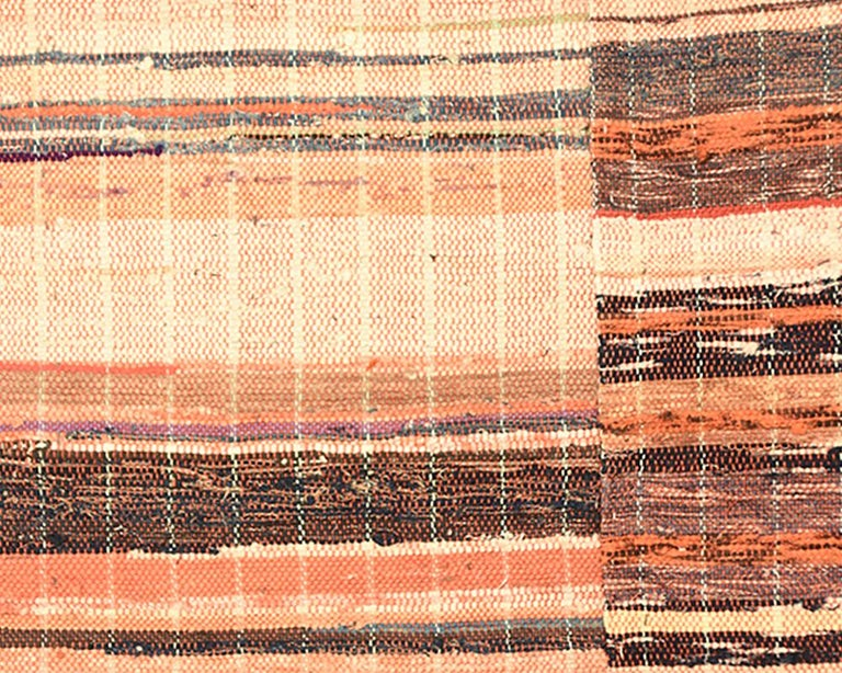 This rug or blanket is handmade using the 'saki-ori' weaving technique which incorporates a recycled rag weft (often made from shredded kimono and other garments), with a cotton warp. Saki, means 'tear' or 'rip' and Ori means 'weaving'.