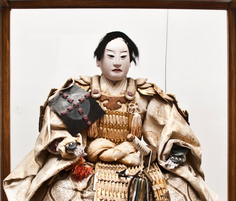 Beautiful antique Samurai Doll, Japanese manufacture, end of 18th century.  Given as a present to young boys becoming adults, it is finely decorated with original 18th century dresses. Shoes and even the sword are realistic and separate from the