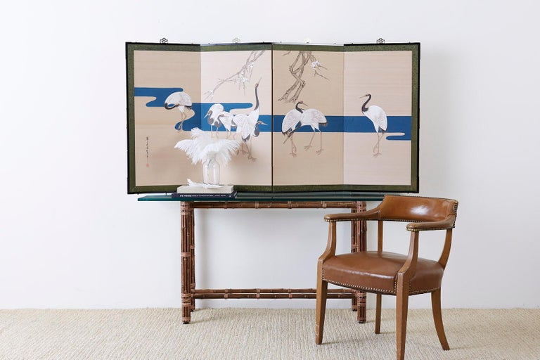 Fantastic Japanese Showa period four-panel byobu screen featuring eight red crowned Japanese cranes or Manchurian cranes. Painted in a modern Rinpa School style with a dramatic effect of bold colored pigments over a gold silk background. A deep
