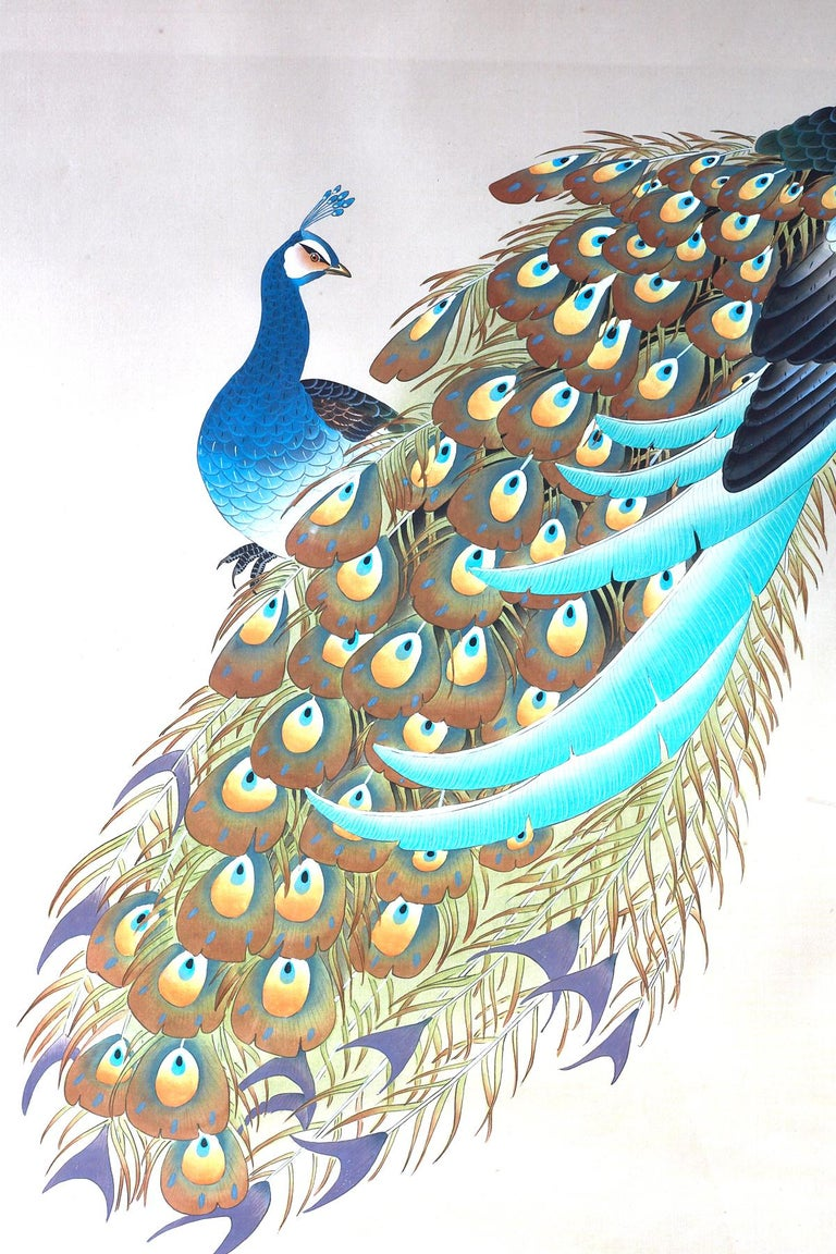 Colorful Japanese ink and color on silk Showa painting of a pair of peacocks. Vivid colors and beautiful details with a signature and seal on right side bottom. Framed in a midcentury painted white frame behind plexiglass.